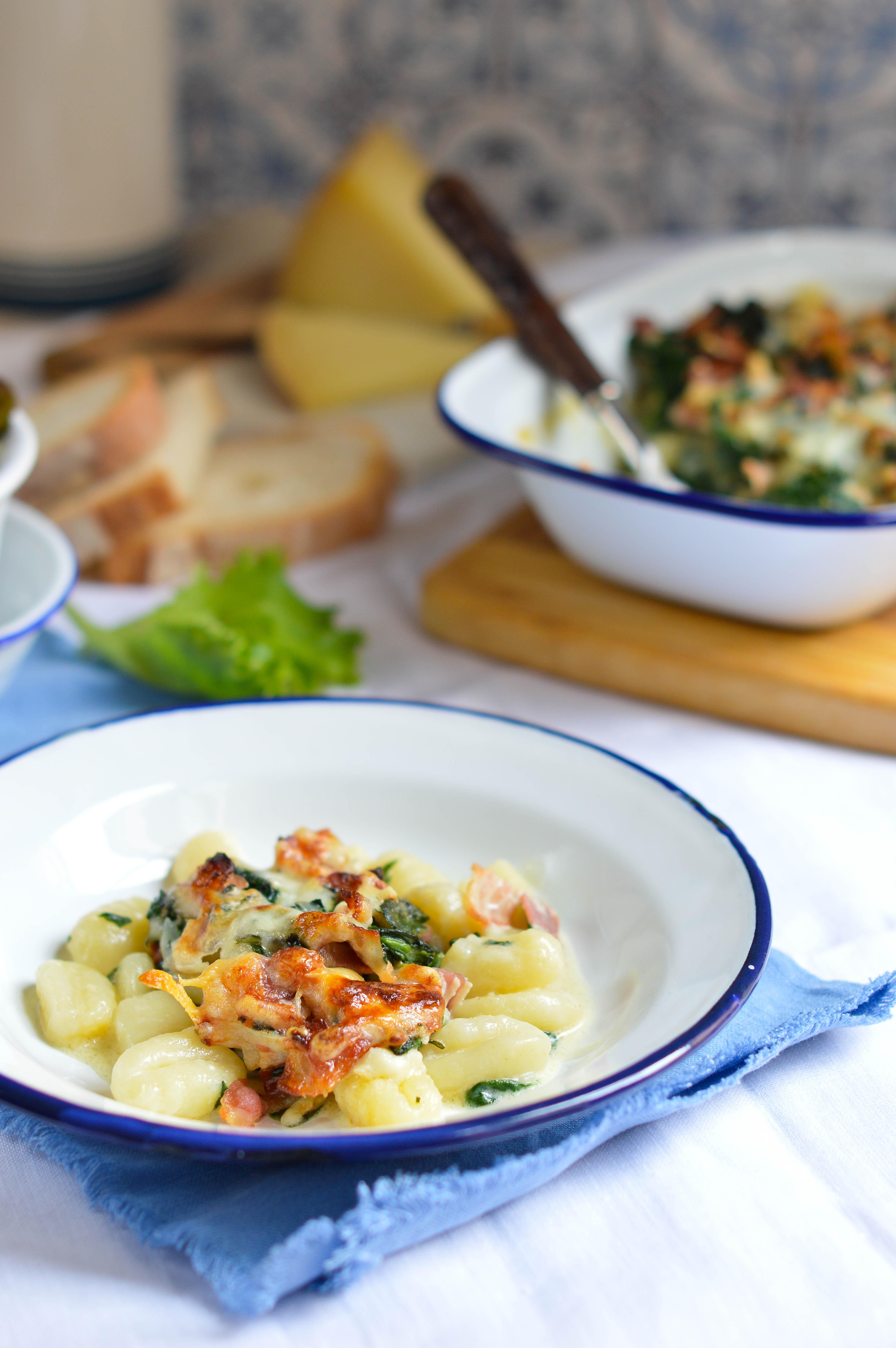 ñoquis gratinados queso manchego y espinacas emplatado